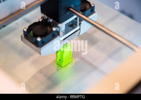 Automatic three dimensional 3d printer performs product creation. Modern 3D printing or additive manufacturing and robotic automation technology - Stock Photo