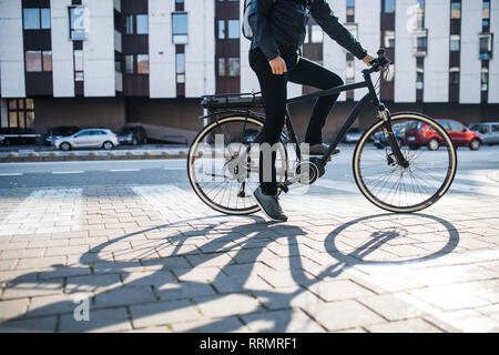 Midsection of unrecognizable male hipster courier with bicycle on a road in city, delivering packages. Copy space. - Stock Photo