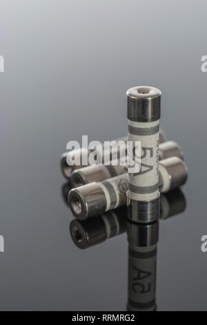 5 Amp household ceramic cartridge fuses. - Stock Photo