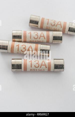 13 Amp household ceramic cartridge fuses. - Stock Photo