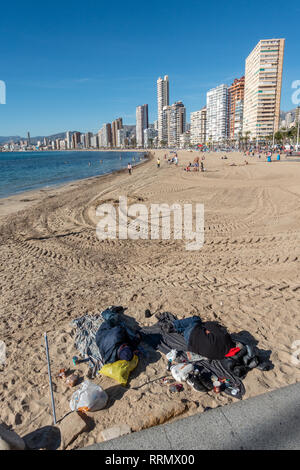 Rough sleepers on Levante beach in Benidorm amongst the holidaymakers just before Christmas - Stock Photo