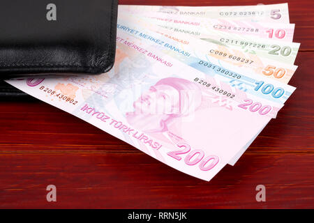 Turkish money - reverse side in the black wallet - Stock Photo