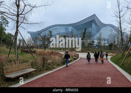Chengdu, China - December 10, 2018: People walking towards the New Century Global Center, the biggest mall in the world in terms of square meters - Stock Photo