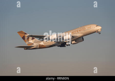 Etihad Airways Airbus A380 jet airliner plane A6-APB taking off from London Heathrow Airport, UK. Airline flight departure - Stock Photo