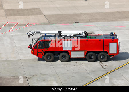 Fire truck on the airport runway - Stock Photo