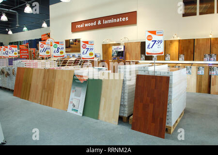 Various wood and laminate flooring for sale in a floor shop - Stock Photo