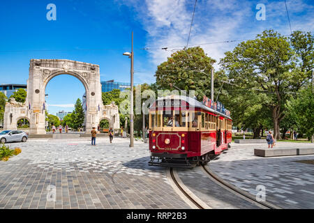 3 January 2019: Christchurch, New Zealand - A vintage tram turns into Cashel Street near the Bridge of Remembrance in the centre of Christchurch. - Stock Photo