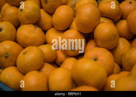 Bright background of ripe orange mandarins. - Stock Photo