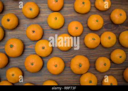 Juicy bright orange tangerines on a wooden background. Fruit set. Background - Stock Photo