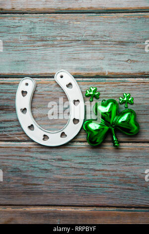 St Patrick's Day lucky horse shoe and green shamrock - Stock Photo