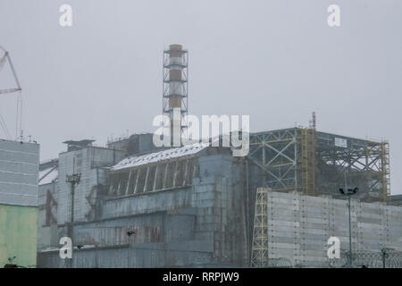 Chernobyl nuclear power plant and sarcophagus. Pripyat, the exclusion zone of the Chernobyl disaster. - Stock Photo