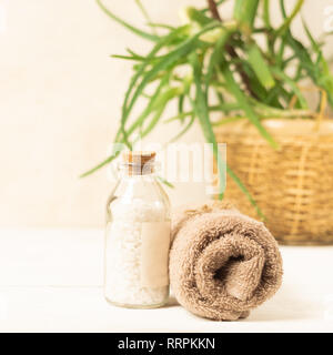 A set of items for the spa procedures. Bath salt, towel on a light background Beauty and body care concept. - Stock Photo