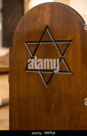 Star of David on a pew in the Old Synagogue Museum, Krakow, Poland - Stock Photo
