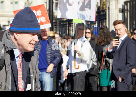 London, UK. 26th Feb, 2019. UK Conservative party politician and Leave supporter Boris Johnson passes Brexit campaigners on his way into Parliament. Credit: Kevin J. Frost/Alamy Live News - Stock Photo