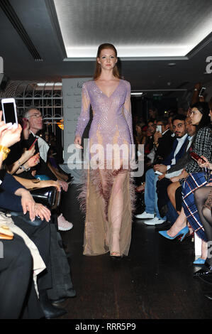 A model seen showcasing during the LFW Nina Naustdal s/s19 catwalk show. Designer previews its spring/summer 2019/2020 collection which was Hosted at Bagatelle, 34 Dover St, Mayfair in London. - Stock Photo