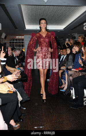London, UK. 26th Feb, 2019. A model seen showcasing during the LFW Nina Naustdal s/s19 catwalk show. Designer previews its spring/summer 2019/2020 collection which was Hosted at Bagatelle, 34 Dover St, Mayfair in London. Credit: Terry Scott/SOPA Images/ZUMA Wire/Alamy Live News - Stock Photo