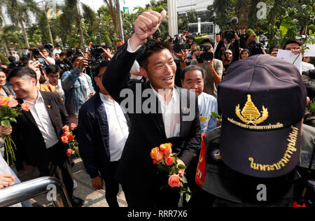 Future Forward Party leader Thanathorn Juangroongruangkit seen gestures to his supporters as he arriving at the Office of the Attorney General in Bangkok. Future Forward Party leader facing charges over anti-junta speech posted earlier on his Facebook page less than a month before long postponed Thailand's national election day. - Stock Photo