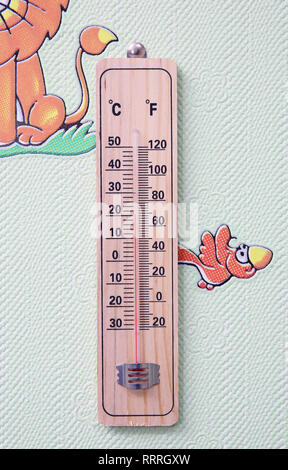 Meteorology thermometer isolated on white background. Thermometer shows air temperature plus 50 degrees celsius . Wall thermometer on a frosty window. - Stock Photo