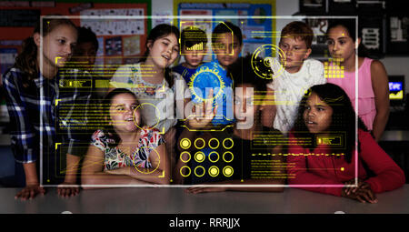 Junior high school students using futuristic touch screen in classroom - Stock Photo