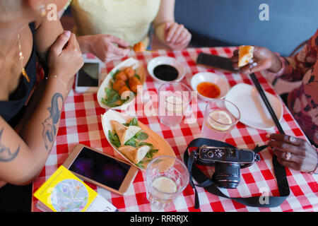 Female tourists eating at restaurant - Stock Photo