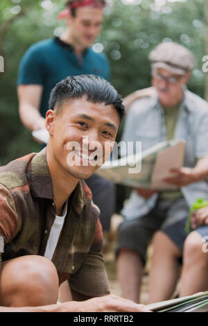 Portrait confident man with map, preparing for hike - Stock Photo
