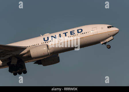 United Airlines jet airliner plane taking off from London Heathrow Airport, UK. Airline flight departure. Space for copy - Stock Photo