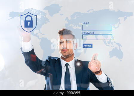 handsome businessman touching security icons, world map and login isolated on white, artificial intelligence concept - Stock Photo