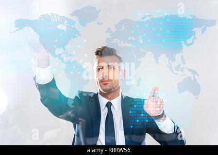 handsome businessman touching innovation technology interface with world map isolated on white, artificial intelligence concept - Stock Photo