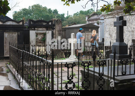 Lafayette Cemetery New Orleans, view of tourists visiting Lafayette Cemetery No.1 in the Garden District of New Orleans, Louisiana, USA - Stock Photo