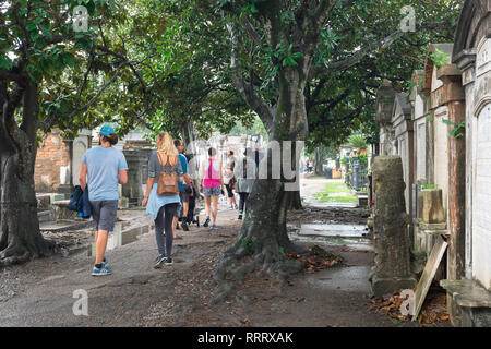 New Orleans Cemetery, view of tourists visiting Lafayette Cemetery No.1 in the Garden District of New Orleans, Louisiana, USA - Stock Photo