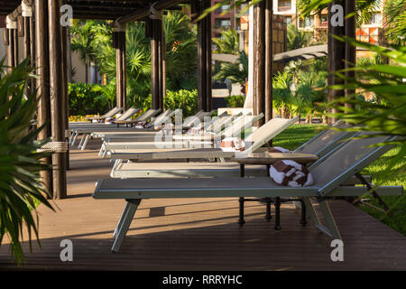 A private lounge area with beach chairs at a luxury resort near Cancun, Mexico. - Stock Photo