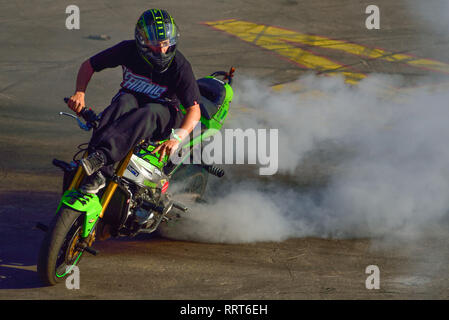 Moscow, Russia - June 7, 2015: Stunt motorcycle rider performing at a local spot. - Stock Photo