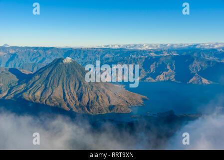 Volcano San Pedro at Lake Atitlan in highlands of Guatemala - Village Santiago and San Pedro you can see -  Aerial View - Stock Photo
