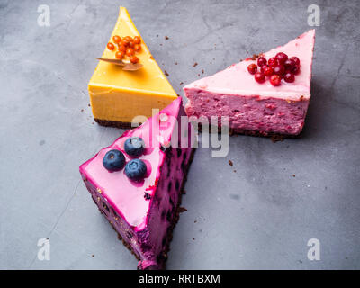 Delicious Raw Vegan cranberry, blueberry, sea buckthorn Cheesecake Close up Healthy Eating Concept - Stock Photo