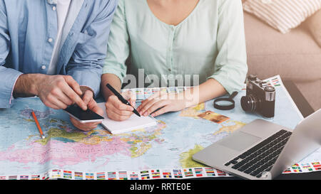 Young couple planning finances for summer vacation