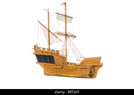 wooden ship model floating in air isolated on white - Stock Photo
