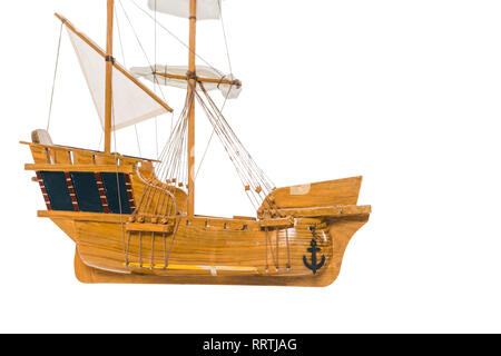 vintage wooden ship model floating in air isolated on white - Stock Photo