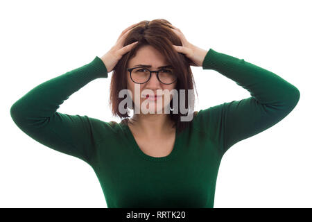 Desperate young woman holding hands in hair throwing a tantrum, having mess in head. Anxiety and headache problems, human mental health. Stressed lady - Stock Photo