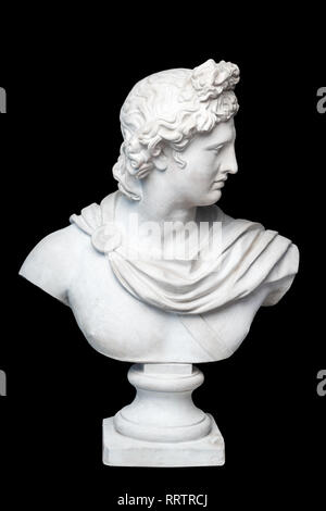 God Apollo bust sculpture. Ancient Greek god of Sun and Poetry Plaster copy of a marble statue isolated on black. - Stock Photo
