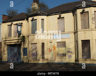 Plants growing out of a closed down, semi derelict former pub (The Burgoyne Arms) in Sheffield, UK. Shut pub - Stock Photo