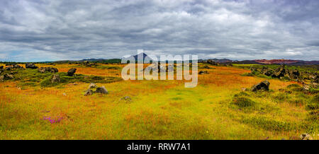 Panoramic view of lava field near lake Myvatn, town Reykjahlid, and volcanoes Hverfjall and Krafla on Iceland - Stock Photo