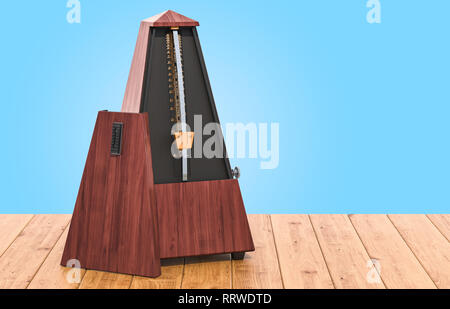 Metronome on the wooden table, 3D rendering - Stock Photo