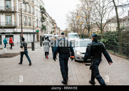 STRASBOURG, FRANCE - DEC 8, 2018: CRS French Police officers securing the zone on Quai des Bateliers street  protection against Yellow jackets Stock Photo