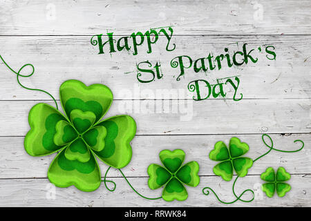 Saint Patricks Day background with green clovers and message - Stock Photo