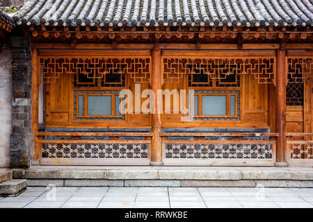 Traditional Wooden Chinese Architecture Of One Storie House. Courtyard Of A Renovated Oriental Building. Carved Details Of Timber. - Stock Photo
