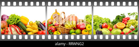 Ripe fruits and vegetables in frame made of photographic film on white background. - Stock Photo
