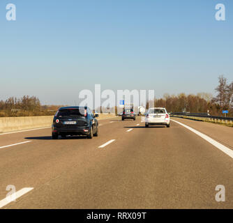Germany - Feb 25, 2018: cars driving on the winter day on the German Autobahn with the direction Offenburg, Basel, Frankfurt - Stock Photo