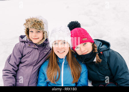 Group of three young girl friends outdoors in winter - outdoor lifestyle fashion portrait of three pretty cheerful girls friends, smiling and having f - Stock Photo