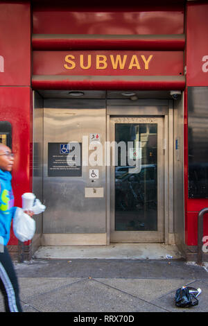 Philadelphia, Pennsylvania - February 5, 2019: Entrance to the handicapped elevator for the SEPTA subway station as seen on this date. A person is wal - Stock Photo