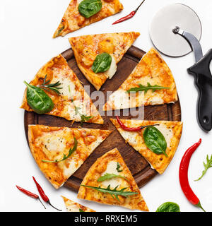 Delicious fresh pizza served on wooden board - Stock Photo